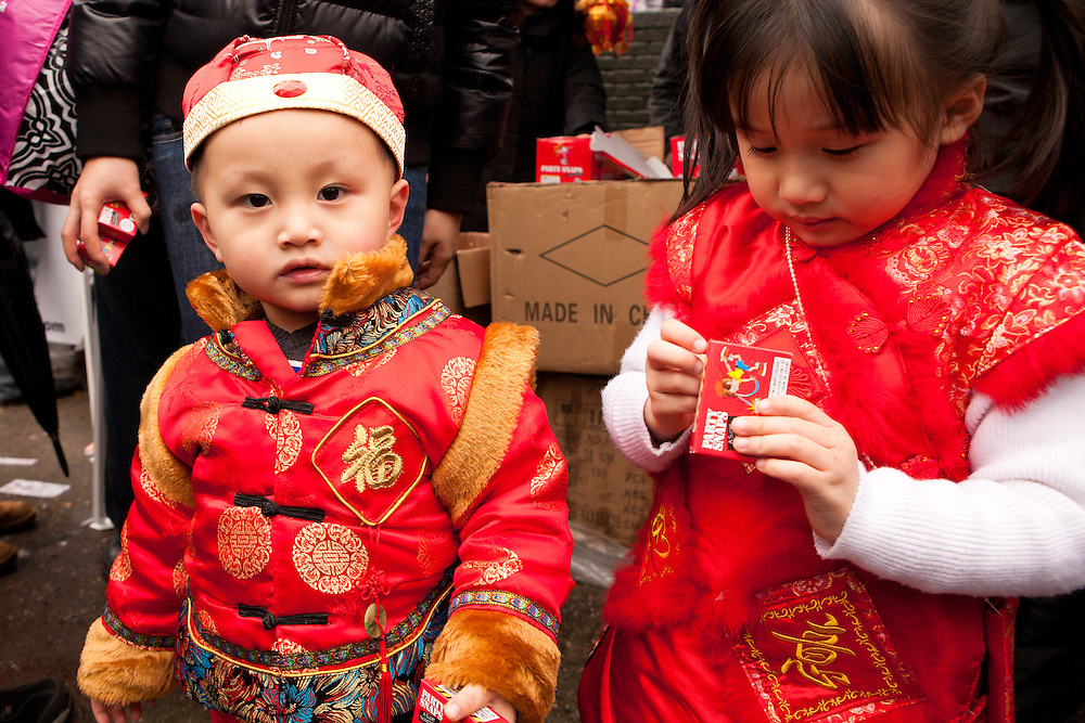 Young spectators in traditional red costumes. Red is a symbol of good luck.