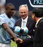 Photo: Paul Greenwood.<br />Manchester City v Aston Villa. The FA Barclays Premiership. 16/09/2007.<br />Micah Richards recieves congratulations from City owner Thaksin Shinawatra