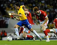 Photo: Ed Godden.<br /> Brazil v Wales. International Friendly. 05/09/2006.<br /> Brazil's Kaka (L) gets away from James Collins.