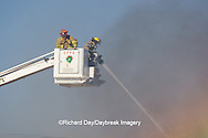 63818-02218 Firefighters extinguishing warehouse fire using aerial ladder truck, Salem, IL