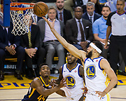 Golden State Warriors center JaVale McGee (1) lays the ball up against the Utah Jazz at Oracle Arena in Oakland, Calif., on December 27, 2017. (Stan Olszewski/Special to S.F. Examiner)