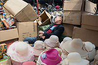 Shanghai, China - April 7, 2013 : salesman sleeping at the city of Shanghai in China on april 7th, 2013