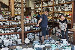 Customers browsing in kitchenware shop in Kappabashi Street in Tokyo which is district famous for many shops selling kitchen products in Japan