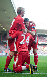 15.08.2010, Anfield, Liverpool, ENG, PL, FC Liverpool vs FC Arsenal, im Bild Liverpool's David Ngog celebrates scoring the opening goal against Arsenal with team-mates Dirk Kuyt and captain Steven Gerrard MBE during the Premiership match at Anfield. l. EXPA Pictures © 2010, PhotoCredit: EXPA/ Propaganda/ David Rawcliffe / SPORTIDA PHOTO AGENCY