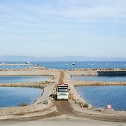 Lo stato di avanzamento dei lavori nel porto di Piombino per accogliere e smantellare il relitto della Costa Concordia. L'Acciaieria Lucchini, se la nave da crociera manterrà la destinazione, che sino ad adesso  per l' armatore di Costa deve essere il porto di Genova, rischia la totale inattività dell' Altoforno 4 (AFO4), quindi la chiusura perchè al momento non ci sono altri lavori in previsione.<br /> 6 giugno 2014 . Daniele Stefanini /  OneShot