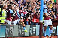 Jack Grealish of Aston Villa (c) celebrates with teammate Aaron Tshibola after he scores his teams 3rd goal .EFL Skybet championship match, Aston Villa v Rotherham Utd at Villa Park in Birmingham, The Midlands on Saturday 13th August 2016.<br /> pic by Andrew Orchard, Andrew Orchard sports photography.