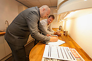 (L-R) Manager Phil Taylor & Customer Colin Beckett