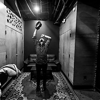 DETROIT - JAN 13: Phil Roebuck stretches backstage before performing at Saint Andrews Hall on Saturday, Jan. 13, 2018 in Detroit.