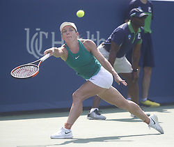 August 19, 2018 - Mason, Ohio - Simona Halep hits the ball while taking on Kiki Bertens at the Western and Southern Open at the Lindner Family Tennis Center in Mason, Ohio on Sunday, August 19, 2018.  Bertens won the match 2-6, 7-6, 6-2.  The Cincinnati Masters is an annual outdoor hardcourt tennis event held in Mason near Cincinnati, Ohio. The event started on September 18, 1899 and is the oldest tennis tournament in the United States played in its original city. (Credit Image: © Leigh Taylor via ZUMA Wire)