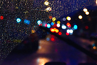The lights of the Gorbals glisten through the window of a taxi on a rainy Glasgow night