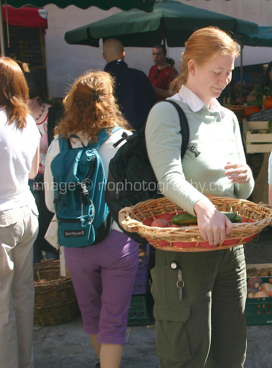 Shoppers at local market, for editorial use only