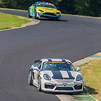 Alton, VA - Aug 26, 2016:  The Bodymotion Racing Porsche 997 races through the turns at the Oak Tree Grand Prix at Virginia International Raceway in Alton, VA.