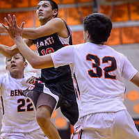 Grants Pirate Matt Vail (10) jumps between Gallup Bengals Patrick Chee (22) and Colton Lowley (32) for a layup during the Gallup Invitational championship Saturday at Gallup High School.
