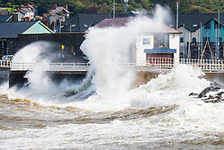 © Licensed to London News Pictures. 09/09/2017. Aberystwyth, UK. Unsettled conditions , high tides and strong autumn winds from the north-east bring huge waves crashing into the harbour wall and the RNI lifeboat station on the seafront in Aberystwyth on the coast of Cardigan Bay in west Wales .Photo credit: Keith Morris/LNP