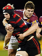 Canterbury lock Craig Clarke is tackled by Southland prop Jamie MacIntosh during the Air New Zealand Cup week 4 Ranfurly Shield match between Canterbury and Southland on Friday August 18, 2006 at Jade Stadium in Christchurch, New Zealand. Canterbury won the game 24-7. Photo: Jim Helsel/Photosport