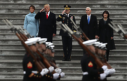 January 20, 2017 - Washington, DC, U.S. - US President DONALD TRUMP salutes a military honor guard with first lady Melania Trump, Vice President Mike Pence and his wife Karen Pence during his inauguration at the United States Capitol, in Washington. (Credit Image: © Gary Hershorn via ZUMA Wire)