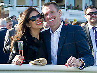 Grand National Meeting - Ladies' Day<br /> e.g. of caption:<br /> National Hunt Horse Racing - 2017 Randox Grand National Festival - Friday, Day Two [Ladies' Day]<br /> <br />   <br /> a couple of racegoers before the 7th race Weatherbys Private Bank Standard Open NH Flat Race (Grade 2) (Class 1)2m 209y, Good<br /> 19 Runners.at Aintree Racecourse.<br /> <br /> COLORSPORT/WINSTON BYNORTH