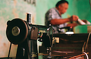 Singer Sewing machine close up with tailor out of focus