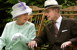 Queen Elizabeth II and the Duke of Edinburgh chat while seated during a musical performance in the Abbey Gardens, Bury St Edmunds during her Golden Jubilee visit to Suffolk. *09/10/03: The Queen, accompanied by the Duke of Edinburgh, was launching a set of revamped train carriages in a visit to London's Kings Cross Station. Great North Eastern Railway has invested  30 million in the refit of all 302 passenger car interiors in their electric 225 fleet. Extra legroom for passengers in standard accommodation, seats with better back support, fresh coffee-making facilities and electric power sockets for laptops are among the improvements.
