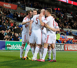 James Collins of Wales (West Ham) celebrates with his team mates after scoring. - Photo mandatory by-line: Dougie Allward/JMP - Tel: Mobile: 07966 386802 03/03/2014 -