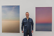 Tillmans with Tag/Nicht II and peninsula - Wolfgang Tillmans: 2017. Tate Modern's new exhibition. Highlights include: large scale photographic works printed especially for this exhibition, including the four-meter tall Weed 2014 and dramatic seascapes such as The State We're In, A 2015;   New 'text and table' sculptures including Time Mirrored 3 2017, on display to the public for the first time; and slide projection Book for Architects 2014. The show is at Tate Modern from 15 February to 11 June 2017.