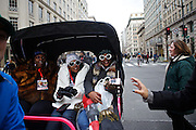 Valaur Dickerson, 37, brown from left, Kynedra Ogunnaike, 37, Stacy Peebles, 38, all from St. Louis, arrive to the line for the parade route in a run by Tom Ball on 14th Street during the inauguration ceremonies for Pres. Barack Obama on January 21, 2013 in Washington, D.C.