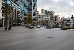 © Licensed to London News Pictures. 15/01/2021. Beirut, Lebanon. The streets in Beirut are empty on the second day of an 11 day curfew (from 14 Jan to 25 Jan) in an attempt to control a rapid increase in rates of COVID-19 Coronavirus in the country. Today, Lebanon registered two record-breaking statistics, with 6154 cases of Coronavirus, and 44 deaths in the past 24 hours. Photo credit : Tom Nicholson/LNP