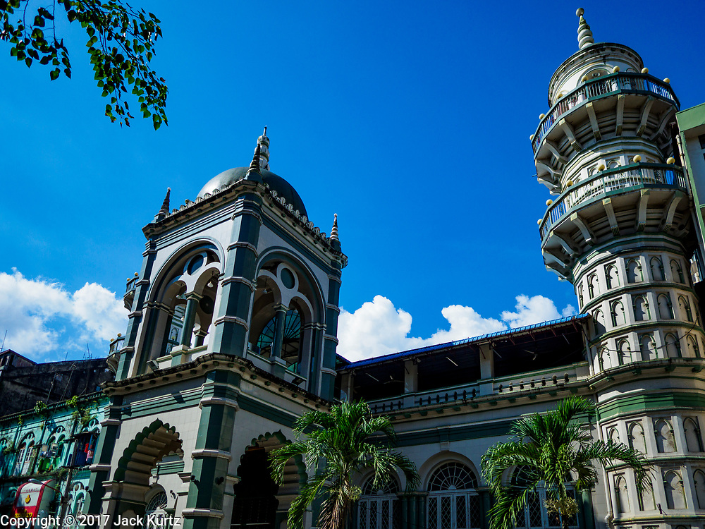 """24 NOVEMBER 2017 - YANGON, MYANMAR: The front of Surtee Sunni Jumma Mosque in Yangon. Many Muslims in overwhelmingly Buddhist Myanmar feel their religion is threatened by a series of laws that target non-Buddhists. Under the so called """"Race and Religion Protection Laws,"""" people aren't allowed to convert from Buddhism to another religion without permission from authorities, Buddhist women aren't allowed to marry non-Buddhist men without permission from the community and polygamy is outlawed. Pope Francis is to arrive in Myanmar next week and is expected to address the persecution of the Rohingya, a Muslim ethnic minority in western Myanmar. Some Muslims and Christians are concerned that if the Pope's comments take too strong of pro-Rohingya stance, he could exacerbate religious tensions in the country.  PHOTO BY JACK KURTZ"""