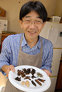 """Shoichi Uchiyama holding a plate of insect ingredients ready for cooking. Tokyo resident Shoichi Uchiyama is the author of """"Fun Insect Cooking"""". His blog on the topic gets 400 hits a day. He believes insects could one day be the solution to food shortages, and that rearing bugs at home could dispel food safety worries."""