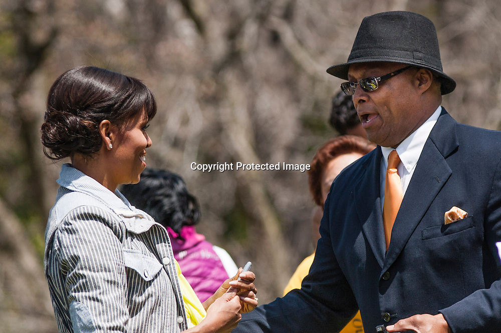 (L-R)First Lady Michelle Obama and School Principal Reggie Mosley of Sarah Moore Greene Magnet Technology Academy School, Knox County, TN speak  during an event where Mosley's  students and the First Lady planted the White House Kitchen Garden for the fifth year in a row at the White House on April 4, 2013 in Washington DC. Photo by Kris Connor