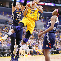 03 August 2014: Los Angeles Sparks guard/forward Armintie Herrington (22) goes for the layup past Connecticut Sun guard/forward Katie Douglas (23) during the Los Angeles Sparks 70-69 victory over the Connecticut Sun, at the Staples Center, Los Angeles, California, USA.