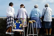 Pensioners enjoying the view at the English seaside, UK