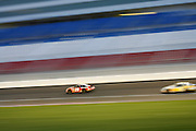 The 20 car usually driven by Tony Stewart on the track at night at the Las Vegas Motor Speedway, Las Vegas, Nevada.