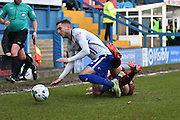 Bury Midfielder, Danny Mayor is tackled by Bradford City Defender, Anthony McMahon during the Sky Bet League 1 match between Bury and Bradford City at the JD Stadium, Bury, England on 5 March 2016. Photo by Mark Pollitt.