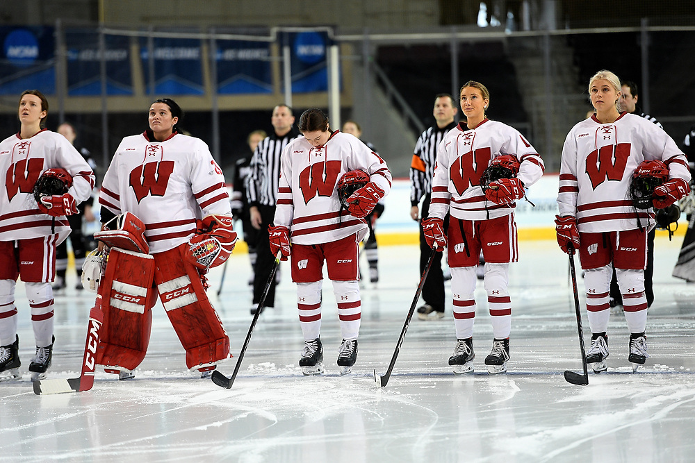 ERIE, PA - MARCH 16: The Wisconsin Badgers stand at attention for the National Anthem before the NCAA Tournament Quarterfinals game against the Providence Friars at the Erie Insurance Arena on March 16, 2021 in Erie, Pennsylvania. (Photo by Justin Berl)