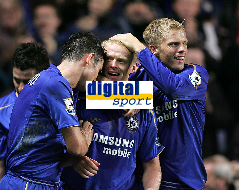 Photo: Lee Earle.<br /> Chelsea v Newcastle United. The Barclays Premiership.<br /> 19/11/2005. Frank Lampard (L) and Eidur Gudjohnsen (R) congratulate Damien Duff (C) after he scored their third.