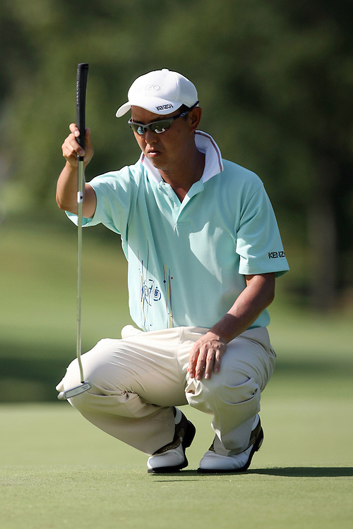 09 August 2007: Toru Taniguchi analyzes the 9th green during the first round of the 89th PGA Championship at Southern Hills Country Club in Tulsa, OK.