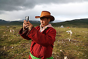 Stunning images reindeer herders of Mongolia<br /> <br /> Tsaatan people are reindeer herders and live in northern Khövsgöl Aimag of Mongolia. Originally from across the border in what is now Tuva Republic of Russia,the Tsaatan are one of the last groups of nomadic reindeer herders in the world. They survived for thousands of years inhabiting the remotest Ulaan taïga, moving between 5 and 10 times a year. <br /> The reindeer and the Tsaatan people are dependent on one another. Some Tsaatan say that if the reindeer disappear, so too will their culture. The Tsaatan depend on the reindeer for almost, if not all, of their basic needs:  their reindeers provide them with milk, cheese, meat, and transportation. They sew their clothes with reindeer hair, reindeer dung fuels their stoves and antlers are used to make tools. They do not use their animals for meat. This makes their group unique among reindeer-herding communities. As the reindeer populations shrink, only about 40 families continue the tradition today. Their existence is threatened by the dwindling number of their domesticated reindeer. Many have swapped their nomadic life for urban areas. <br /> <br /> Tsaatan selfie with Bayrsaïhan<br /> ©Pascal MANNAERTS/Exclusivepix Media