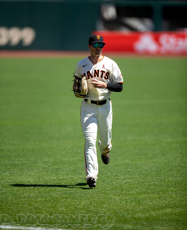 San Francisco Giants center fielder Mike Yastrzemski runs off the field after making the final out of the top of the third inning of a baseball game against the Los Angeles Dodgers on Thursday, Aug. 27, 2020 in San Francisco, Calif. (D. Ross Cameron/SF Chronicle)