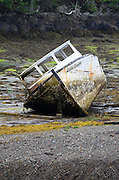 The extreme tides around Campobello Island have left this derelict boat stranded on the sea bottom until the tide comes back in.