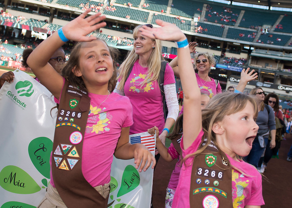 Girl Scouts walk the field at Angel Stadium before the game Saturday.<br /> <br /> ///ADDITIONAL INFO:   <br /> <br /> angels.0508.kjs  ---  Photo by KEVIN SULLIVAN / Orange County Register  --  5/7/16<br /> <br /> The Los Angeles Angels take on the Tampa Bay Rays at Angel Stadium Saturday.<br /> <br />  5/7/16