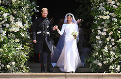 © Licensed to London News Pictures. 19/05/2018. London, UK.  Prince Harry, The Duke of Sussex and Meghan Markle, The Duchess of Sussex are pictured leaving St George's Chapel in Windsor Castle following a wedding ceremony. Photo credit: LNP