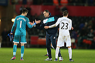 Paul Clement, the Swansea city manager © congratulates Lukasz Fabianski and Gylfi Sigurdsson of Swansea city at the end of the match. Premier league match, Swansea city v Southampton at the Liberty Stadium in Swansea, South Wales on Tuesday 31st January 2017.<br /> pic by  Andrew Orchard, Andrew Orchard sports photography.