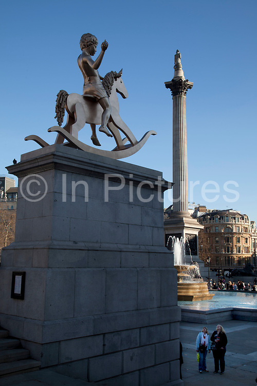 """A 4.1m high bronze sculpture of a boy on a rocking horse has been unveiled on the Fourth Plinth in Trafalgar Square, London, England, UK. Artists Michael Elmgreen and Ingar Dragset say """"Powerless Structures, Fig 101 (the title of the piece) questions """"monuments predicated on military victory or defeat"""". They said it was """"up to the public to love it or hate it"""" but """"hopefully not ignore it"""". Funded by the Mayor of London and Arts Council England, the sculpture will remain in place for a year. The artists said, in a statement, that """"the image of a young boy astride his rocking horse encourages viewers to consider the less spectacular events in their lives which are often the most important"""". The Fourth Plinth is an empty plinth in Trafalgar Square in central London originally intended to hold an equestrian statue. For over 150 years there was much squabbling about what to do with the fourth plinth, but very little agreement, until the temporary use of the plinth to display three pieces of art in the last years of the 20th century lead to a commission being formed to decide on a use for it. Eventually that commission unanimously decided to use it for the temporary display of artworks."""