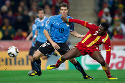 Andres Scotti of Uruguay vs Asamoah Gyan of Ghana during the overtime at  2010 FIFA World Cup South Africa Quarter Finals football match between Uruguay and Ghana on July 02, 2010 at Soccer City Stadium in Sowetto, suburb of Johannesburg. Uruguay defeated Ghana after penalty shots. (Photo by Vid Ponikvar / Sportida)