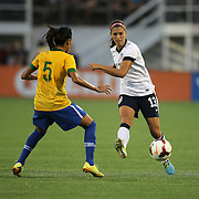 Brazil defender Thaisa (5) defends against U.S. forward Alex Morgan (13) during a women's soccer International friendly match between Brazil and the United States National Team, at the Florida Citrus Bowl  on Sunday, November 10, 2013 in Orlando, Florida. The U.S won the game by a score of 4-1.  (AP Photo/Alex Menendez)