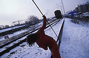 Kosovar Roma refugee, living between the train tracks and the international centre. Trains used the same tracks to ferry Yugoslav Jews and Roma to the concentration camps during the Holocaust. Belgrade, Serbia Winter 2004
