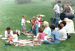 Aug. 7, 1988 - Kennebunkport, Maine, United States of America - Kennebunkport, Maine - August 7, 1988 -- United States Vice President George H.W. Bush is surrounded by his children and grandchildren at the family home in Kennebunkport, Maine on August 7, 1988.  Future United States President George W. Bush is at the upper right corner of the photo..Credit: White House via CNP (Credit Image: © White House/CNP/ZUMAPRESS.com)