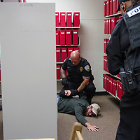 Officer Douglas Hoffman arresting Charles Wommack who played the active shooter in Thursday morning's drill at the Octavia Fellin Public Library.