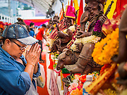 07 SEPTEMBER 2014 - BANGKOK, THAILAND: A woman prays at a statue of Ganesh during the Ganesh Festival at Central World in Bangkok. Ganesh Chaturthi, also known as Vinayaka Chaturthi, is a Hindu festival dedicated to Lord Ganesh. It is a 10-day festival marking the birthday of Ganesh, who is widely worshiped for his auspicious beginnings. Ganesh is the patron of arts and sciences, the deity of intellect and wisdom -- identified by his elephant head. The holiday is celebrated for 10 days, in 2014, most Hindu temples will submerge their Ganesh shrines and deities on September 7.     PHOTO BY JACK KURTZ